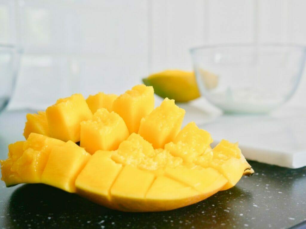 Mango pieces with coconut yogurt behind