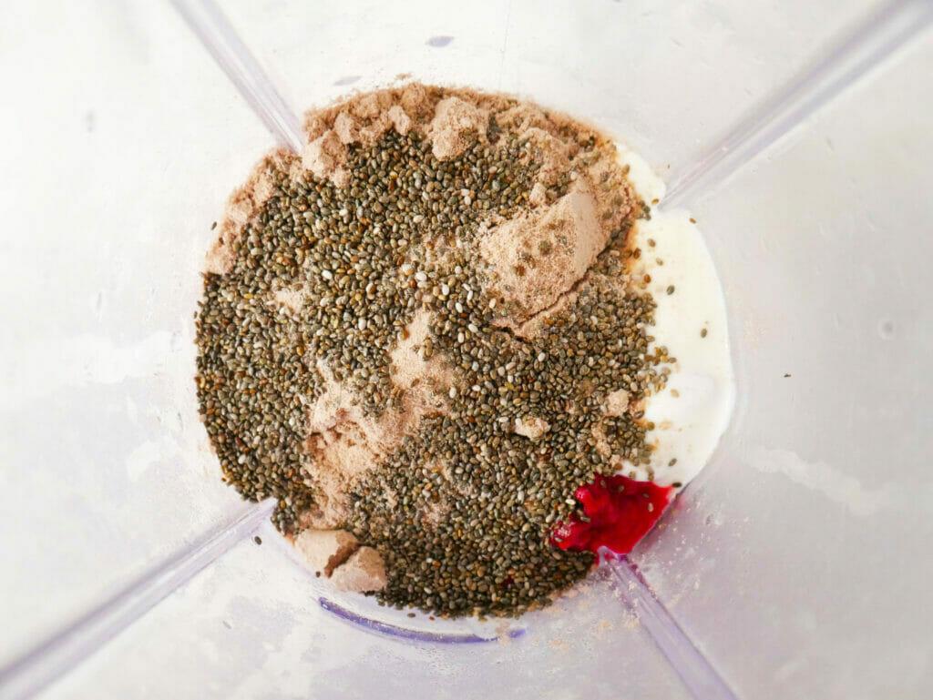 Raspberry yogurt protein smoothie ingredients in blender